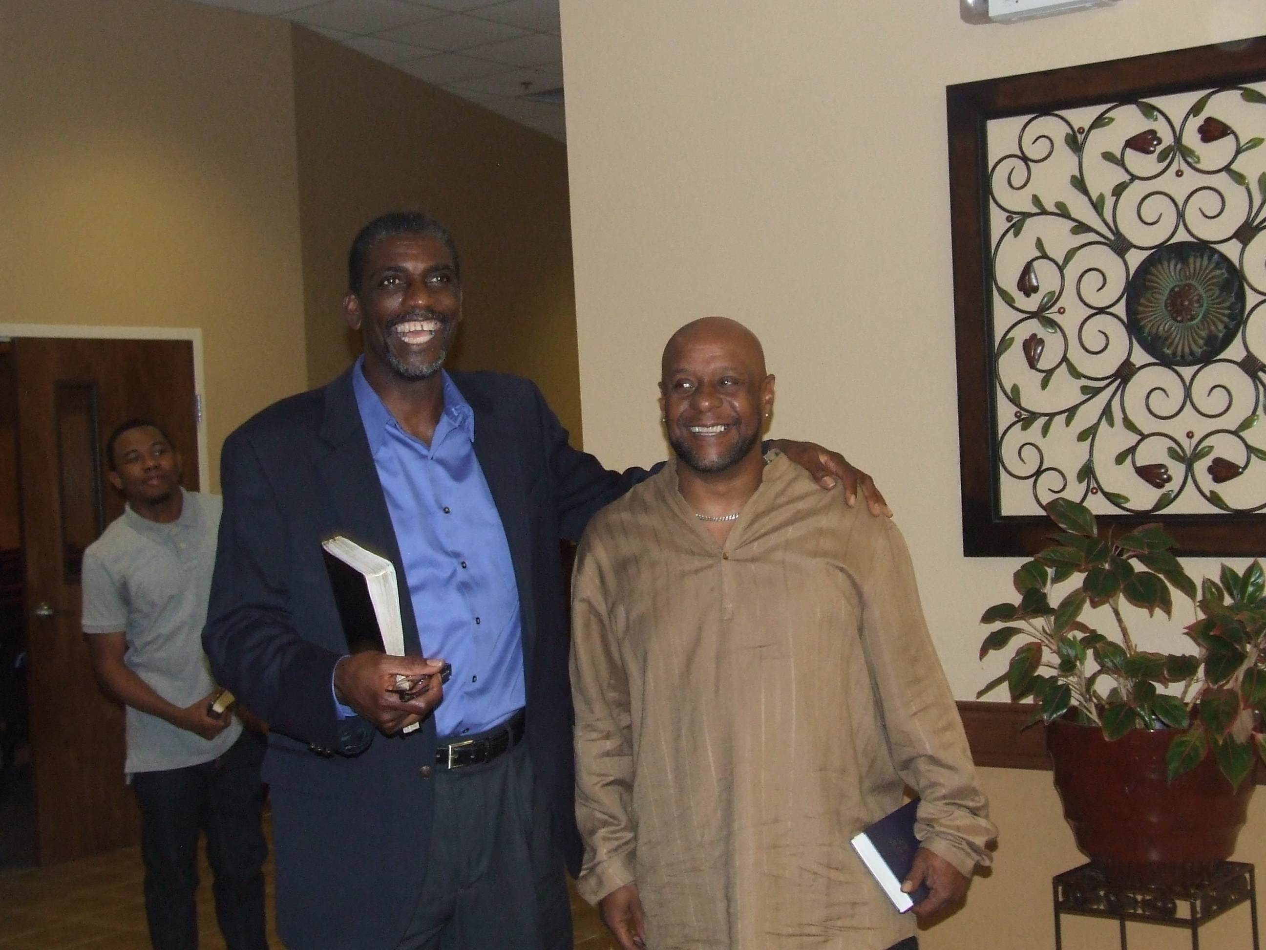 Pastor and people from the congregation