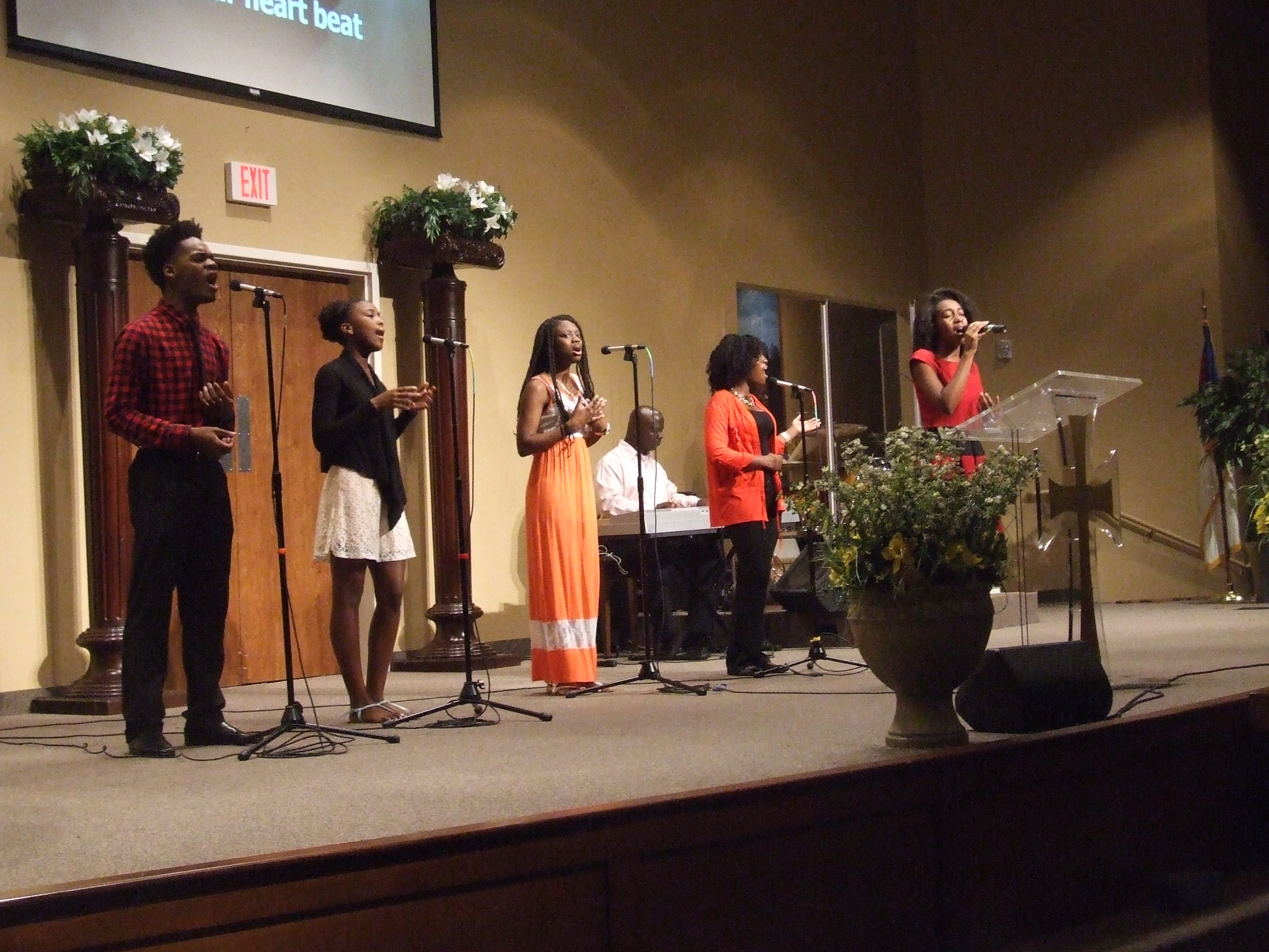 Teens doing praise and worship on the stage