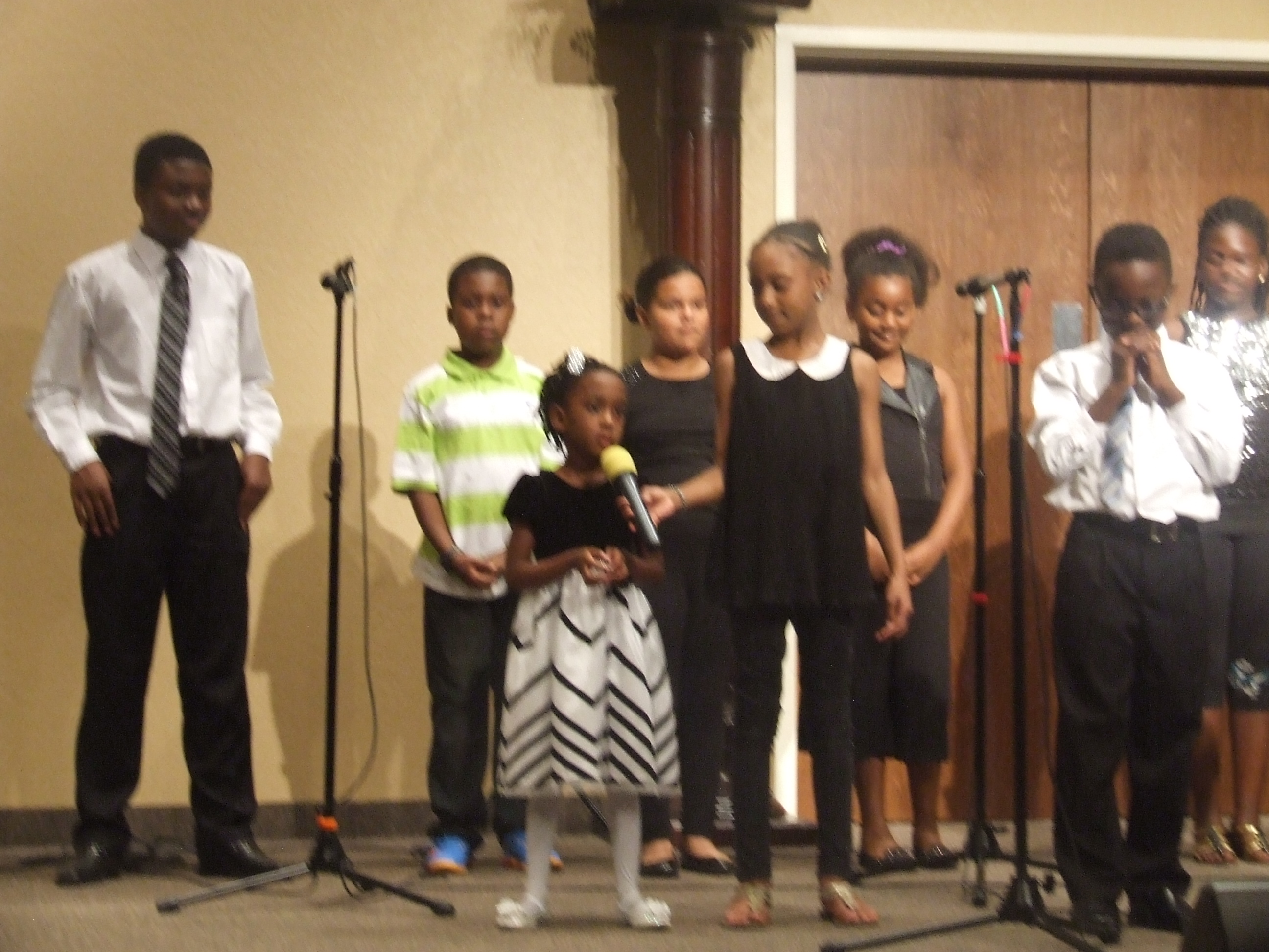 young children singing on stage