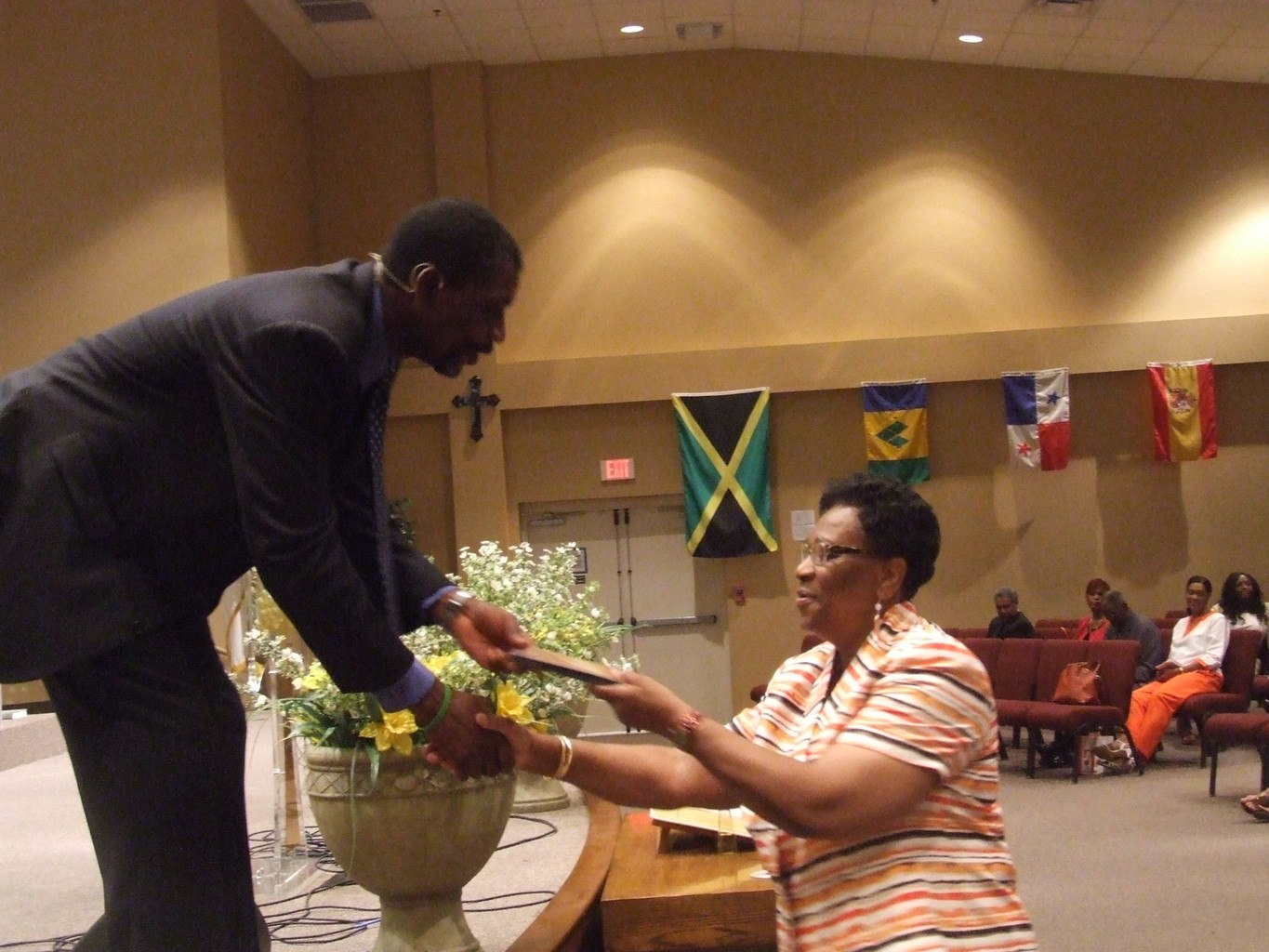 Pastor handing a gift to a lady