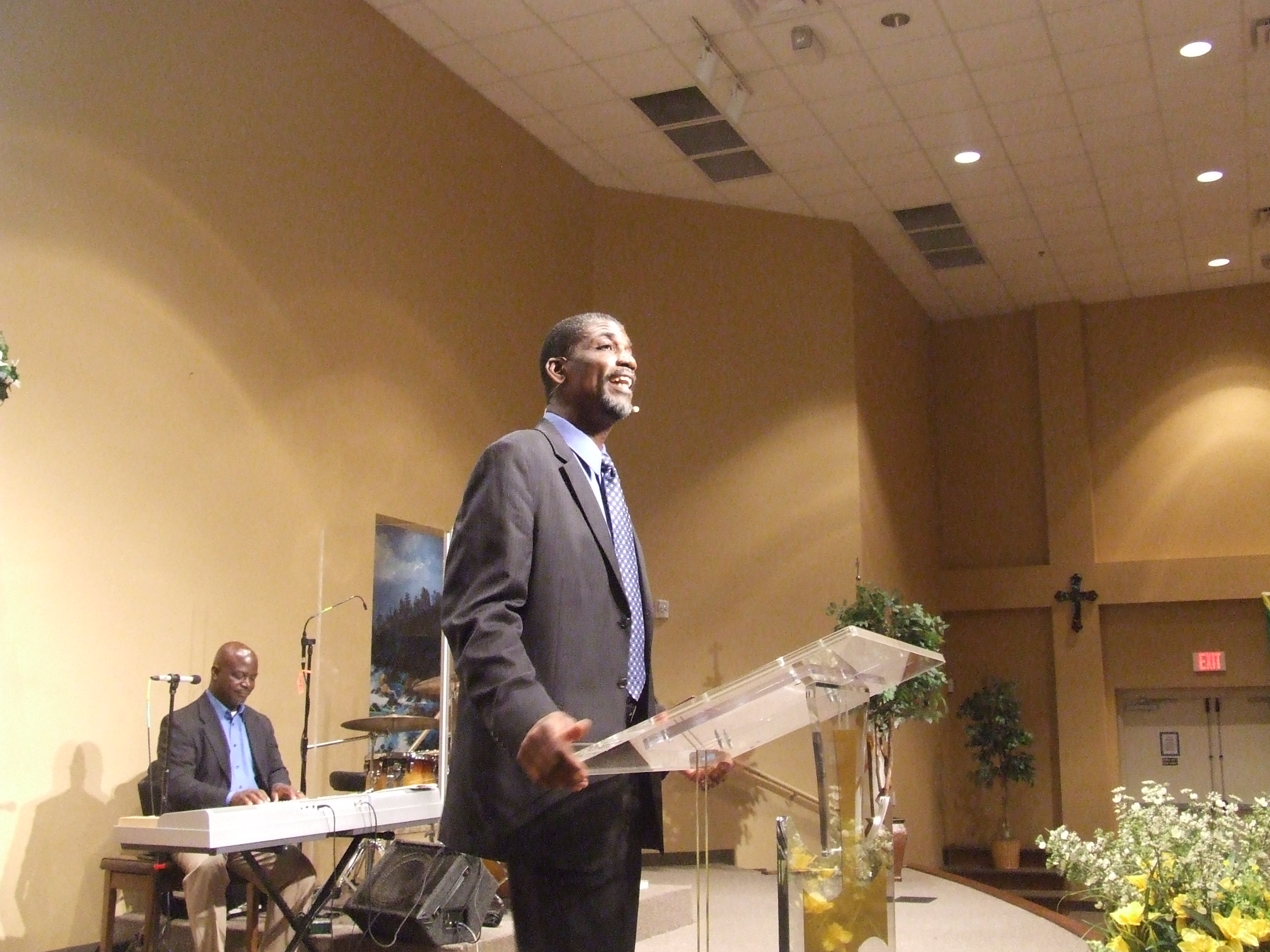 Pastor Benjamin at the podium speaking