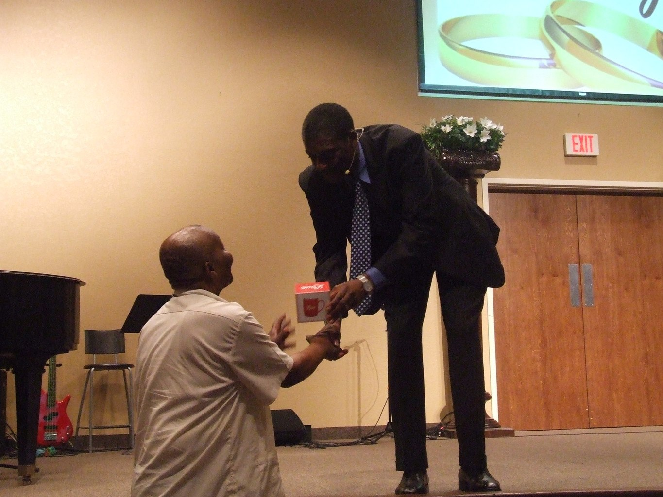 Pastor handing a gift to a man