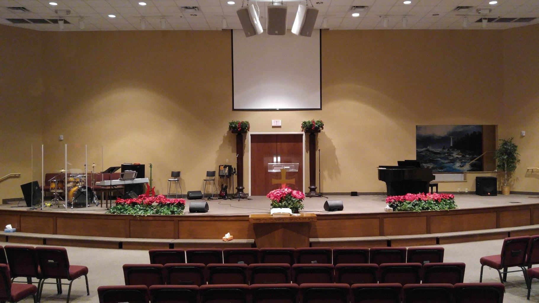 podium showing full and some of the chairs in the congregation
